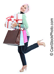 Happy of standing young woman with shopping bag and gift...