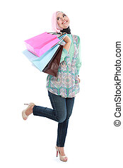 Happy of standing muslim woman with shopping bag isolated...