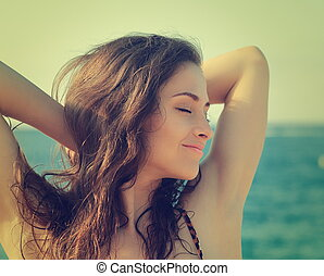 Vintage portrait of woman enjoying on summer sea Closeup