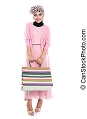 Happy young asian woman with shopping bag