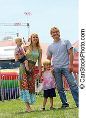 Happy Family at Circus - a happy smiling family of four...