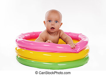 Baby swimming in kid inflatable pool, isolated on white...