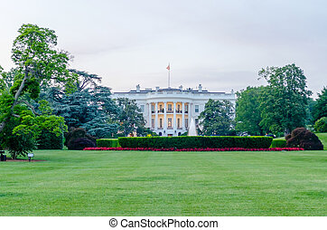 The White House in Washington DC against a cloudy sky