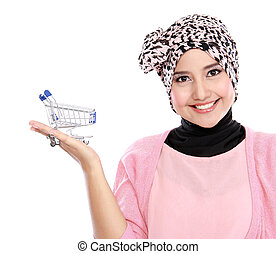 Attractive asian muslim woman with shopping cart isolated on...