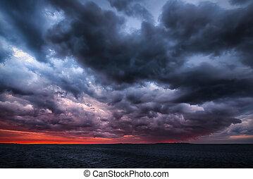 Storm on an ocean sunset