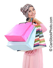 Happy of attractive young muslim woman with shopping bag...