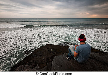 Fishing on the cliff