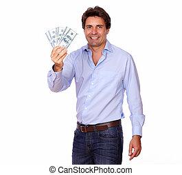 Smiling handsome man holding cash dollars