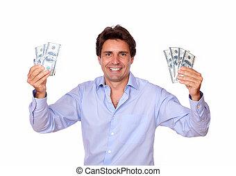 Smiling fashionable man holding cash money