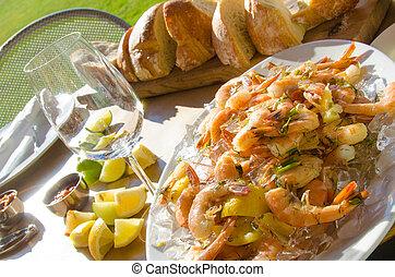 Al fresco dining with fresh shrimp and crusty bread.