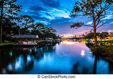 A Very Colorful Mythical Sunset Over water way near ocean