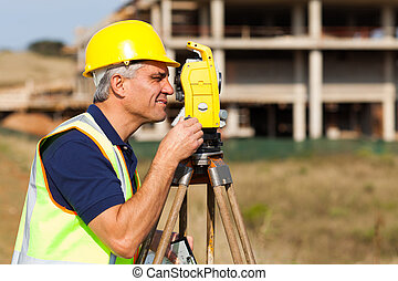 senior land surveyor working with theodolite - Senior land...