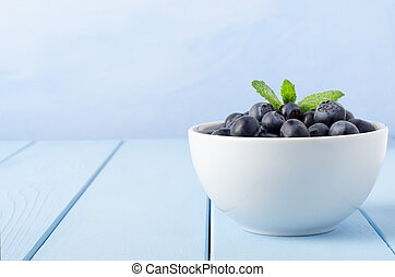 Bowl of Blueberries on Blue