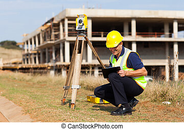 middle aged land surveyor working outdoors