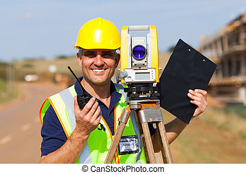 senior land surveyor - happy senior land surveyor with...