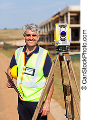 senior land surveyor portrait - happy senior land surveyor...