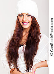 cute young woman with long hair wearing a white hat