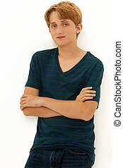 Attractive Teen Boy Caucasian leaning on wall with arms...