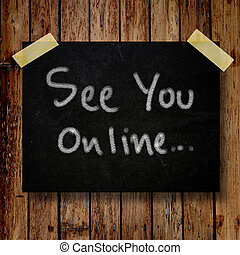 See you online on message note with wooden background
