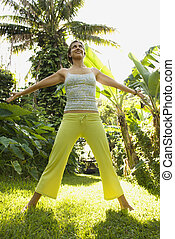 Woman practicing fitness. - Caucasian mid-adult woman...