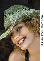 Portrait of woman in hat.