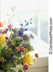 Flower arrangement by window.