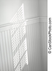 Sun through window blinds on wall. - Sun spot on wall from...