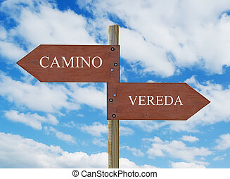 CAMINO vs VEREDA - wooden crossroad sign on cloudy...