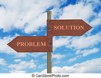 PROBLEM vs SOLUTION - wooden crossroad sign on cloudy...