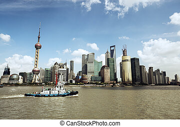 shanghai skyline and a tugboat - shanghai skyline at daytime...