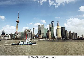 shanghai skyline and a tugboat - shanghai skyline at daytime...
