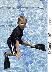 Boy Jumping Off of Diving Board wit