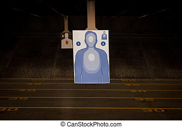 Target Practice at the Gun Range - Paper target ready for...