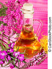 Essential oil with colorfull blossoms