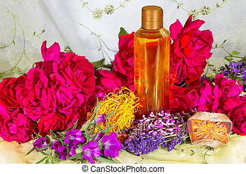 Bath oil or essential oil with roses and herbs
