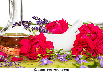 Essential Oil - Essntial Oil and roses in a mortar
