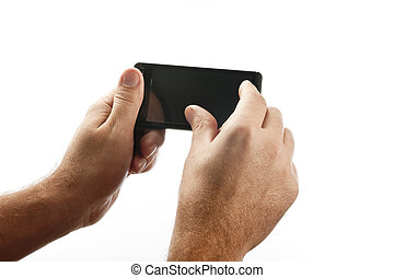 Handheld device interaction - Hands holding a smartphone,...