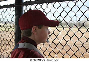 Sidelined - Youth baseball player sidelined with an injury