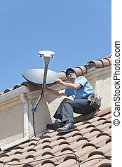 Satellite Installer on Roof 2 - Installation of satellite...