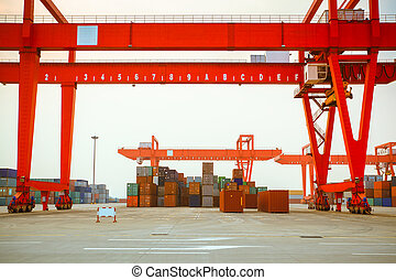 container yard - containers and cranes in an intermodal yard
