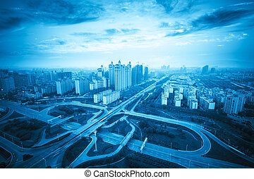 city highway interchange at sunset with blue tone