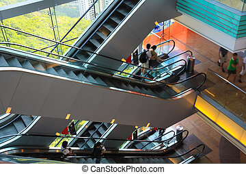 multilayer escalator in the modern building in Hong...