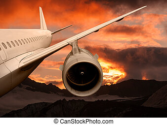 plane is flying at sunset. airplane on a background of the...