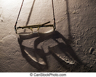Eye glasses - Old glasses hung on the wall with the ambient...