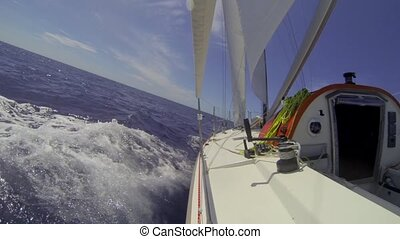 Racing yacht tacking upwind over th - Small single handed...
