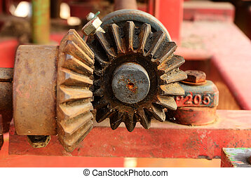 Close up on the old bevel gears on agriculture machine