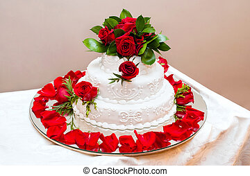 Wedding cake with red roses - the wedding cake decorated...