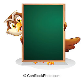 An owl hiding at the back of a blackboard