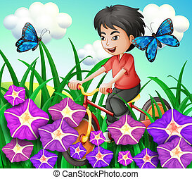 A boy biking in the garden with flowers and butterflies -...