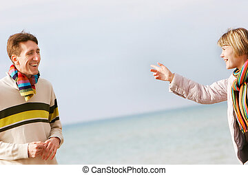 young couple isolated over sky and sea background